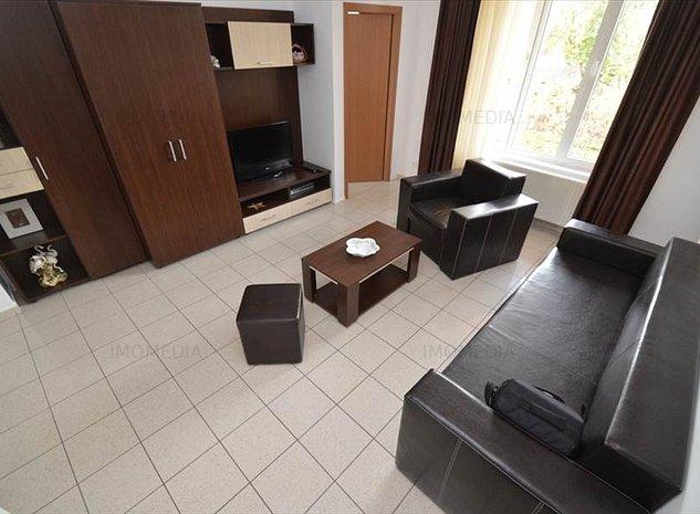 Apartament la curte comuna - imaginea 1