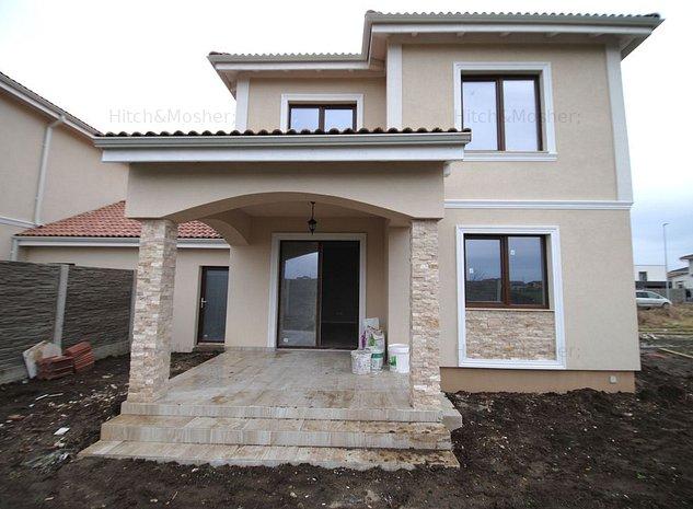 Casa cu garaj si teren de 980 mp in Dumbravita - imaginea 1