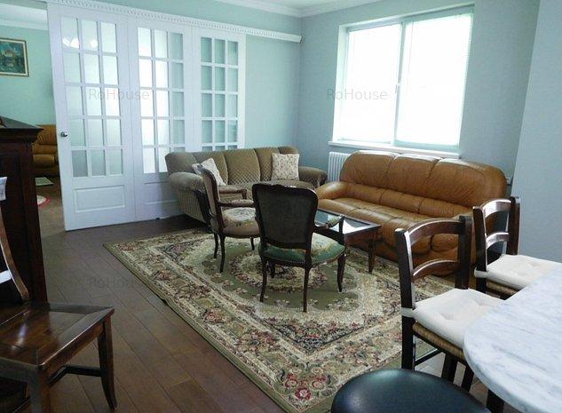 Un apartament decorat si amenajat frumos - imaginea 1