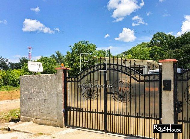 Jandarmeriei - Stejarii, teren 443 mp, 2 hale auto echipate si casa de locuit - imaginea 1
