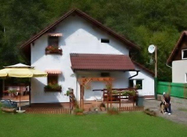 Pensiune montana cu 7 camere, la 50 km de Sibiu, situata pe malul raului - imaginea 1