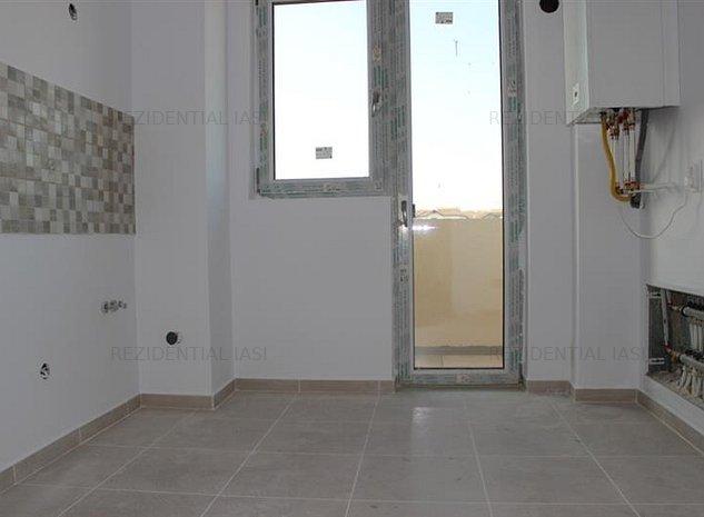 Apartament cu 2 camere, decomandat, zona capat Cug Iasi, bucatarie inchisa - imaginea 1