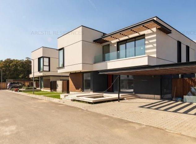 Casa cu arhitectura desodebita - imaginea 1