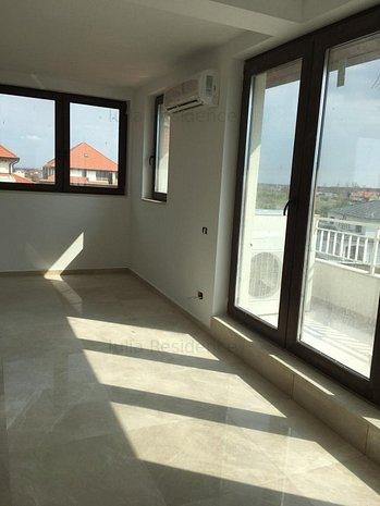 Apartament mansarda pe 2 nivele - imaginea 1