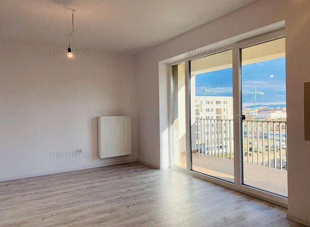 Apartament 2 camere tip Studio in Tractoru(Coresi)  - imaginea 1