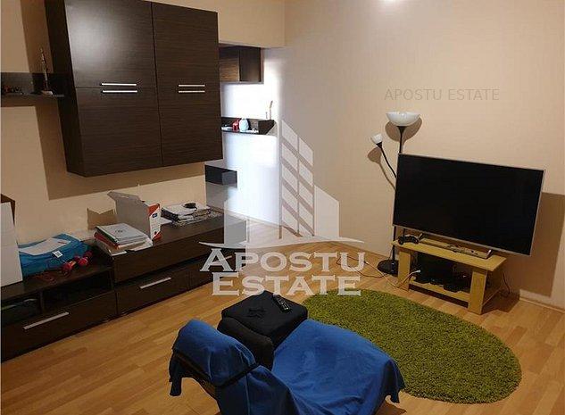 Apartament cu 2 camere in zona Dambovita, centrala proprie - imaginea 1