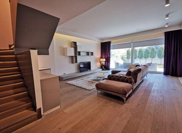 Apartament cu gradina, ultrafinisat, mobilier modern si garaj - imaginea 1