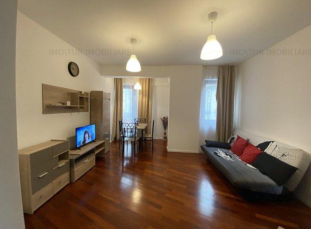 Apartament modern situat intr-un bloc nou| Loc de parcare la subteran - imaginea 1