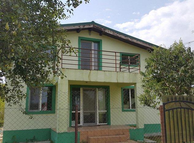 Casa 4 camere in zona pitoreasca de deal Viperesti - imaginea 1