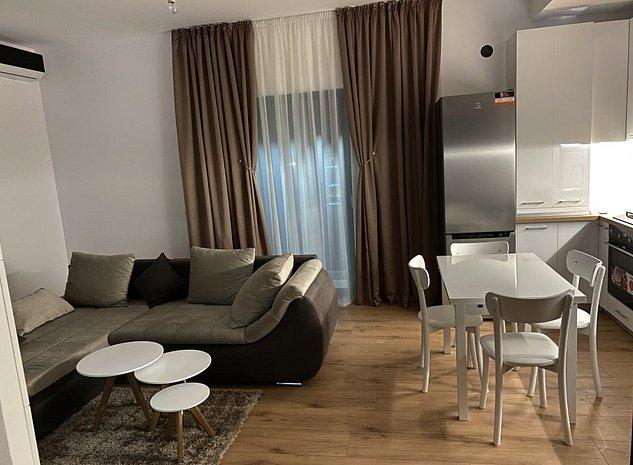 Apartament de lux Otopeni cu terasa şi loc de parcare in complex rezidential - imaginea 1